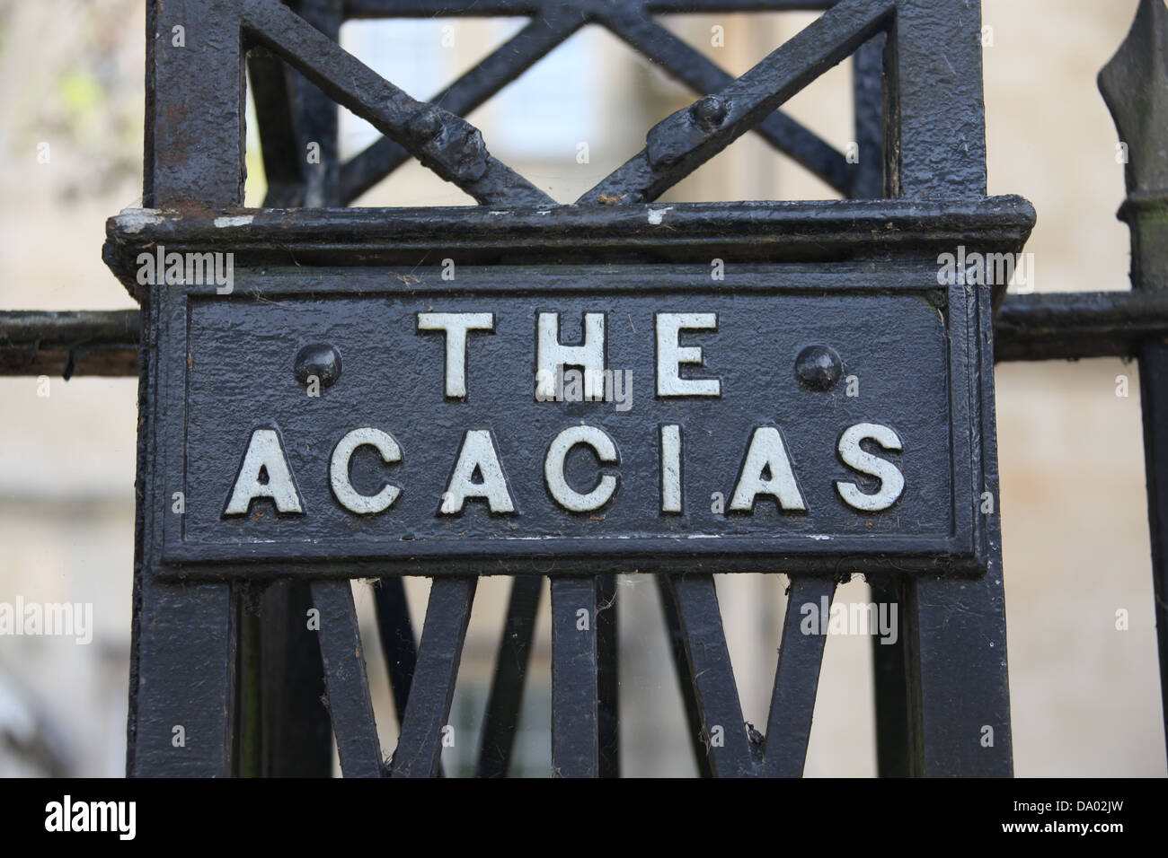A cast Iron nameplate for a prestigious house in an urban location with black and white lettering. - Stock Image