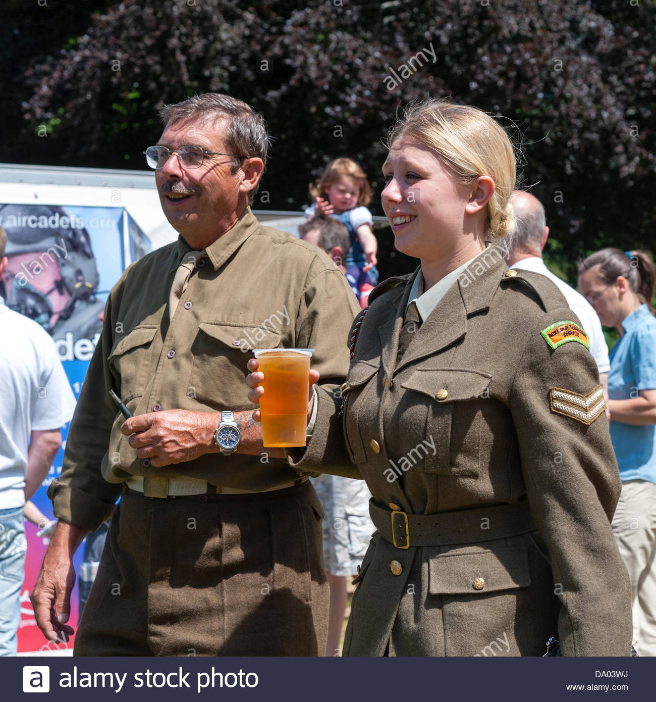 Cardiff, Wales, UK. 29th June 2013. Armed Forces Day 2013 Cardiff, UK. ATS Young woman in uniform drinking a pint Stock Photo