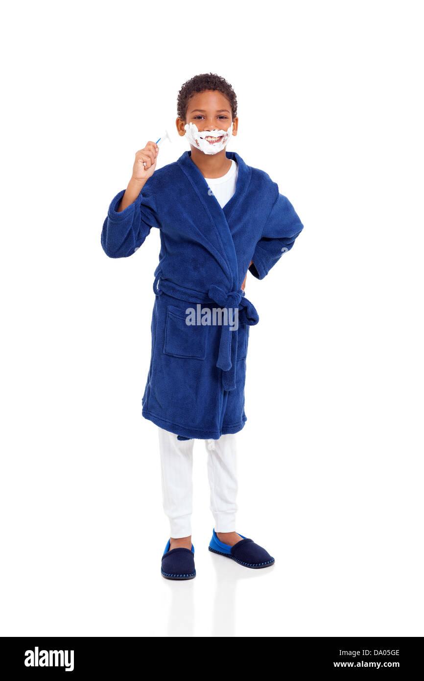 playful little boy shaving face isolated on white Stock Photo