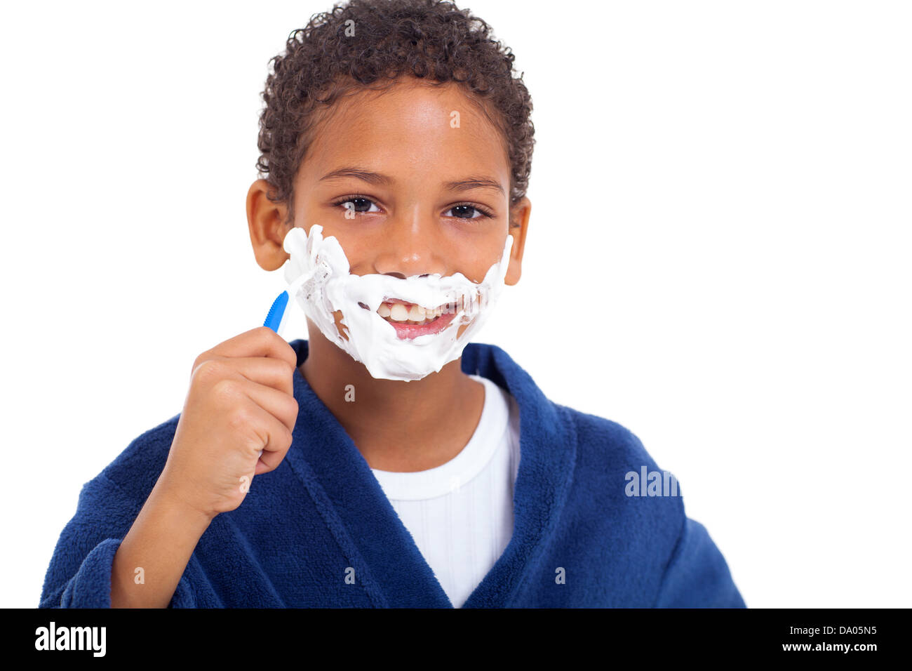 playful little african young boy shaving face over white background Stock Photo