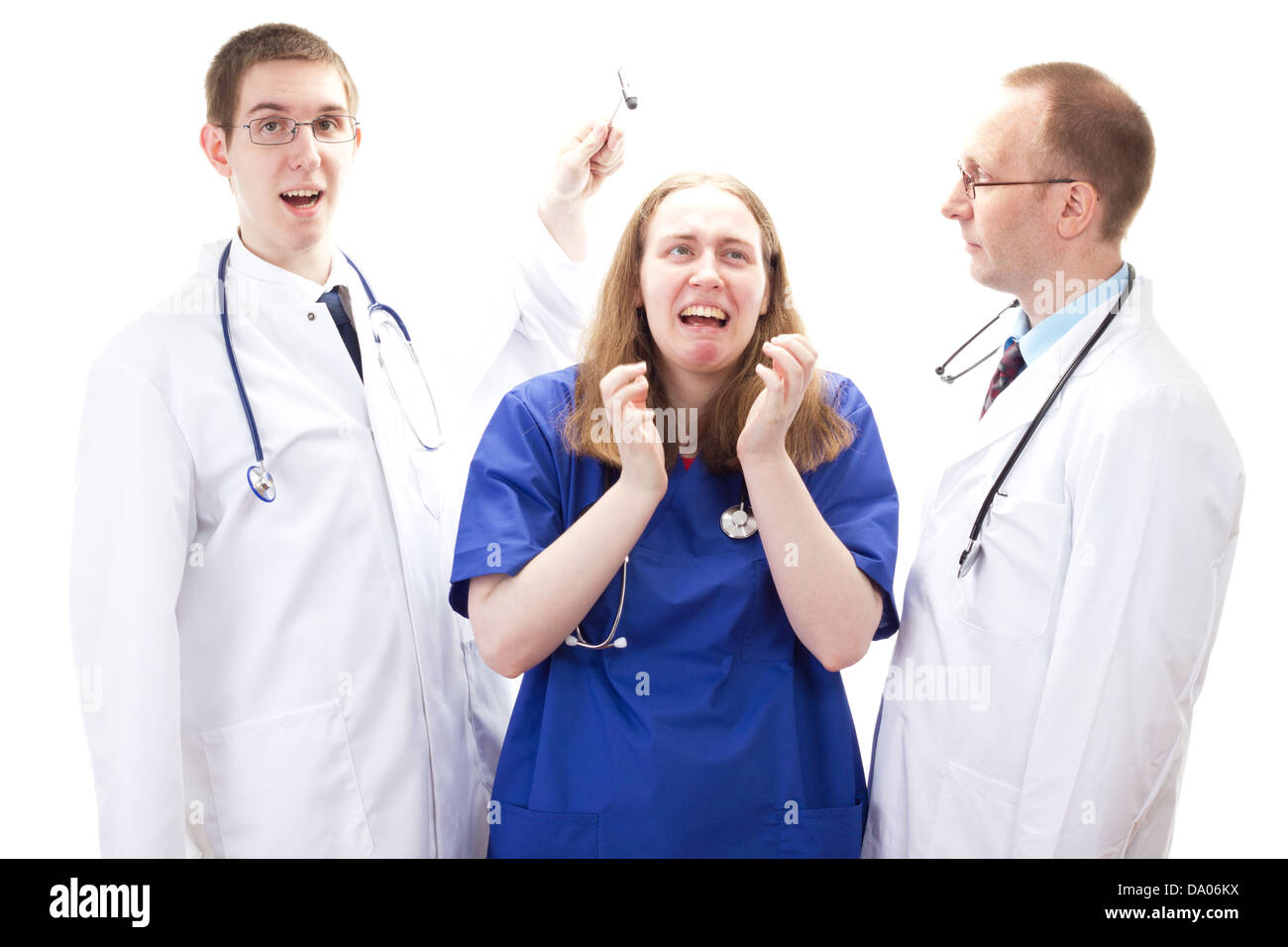 Young female nurse suffer bullying at work - Stock Image