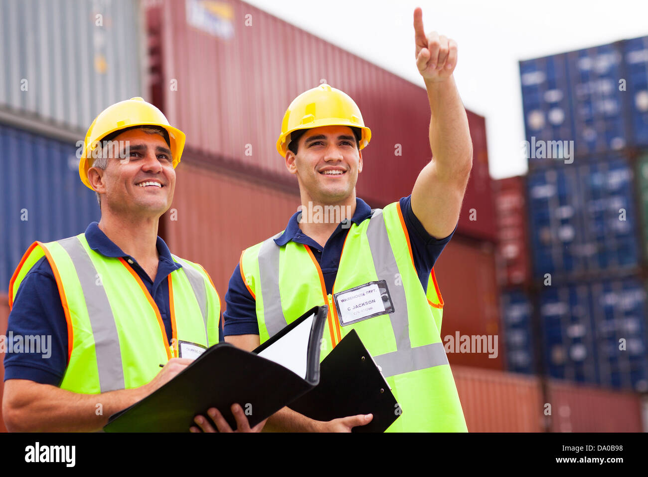 two inspectors doing inspection at the harbor container yard - Stock Image