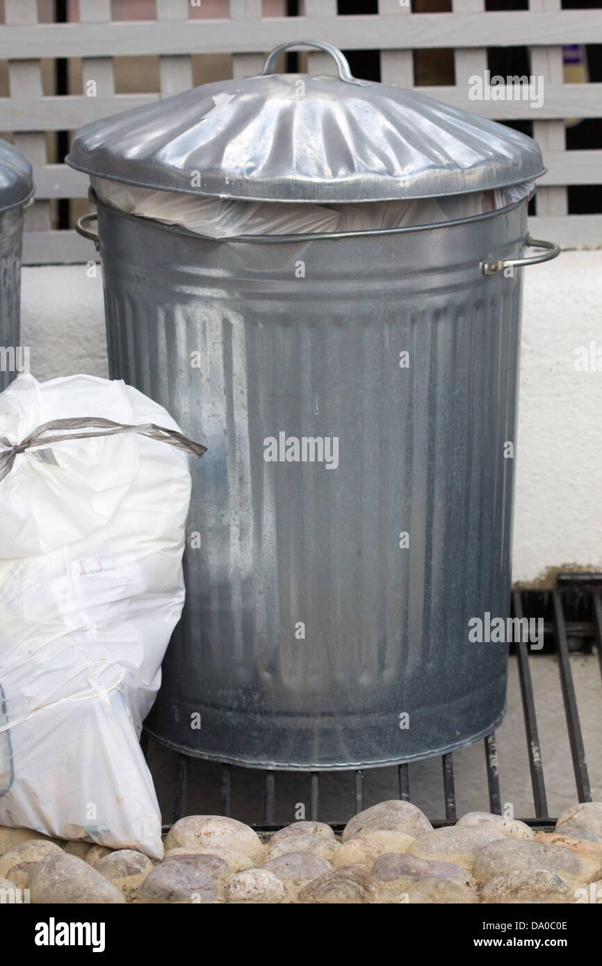 Aluminum bin and rubbish bag - Stock Image