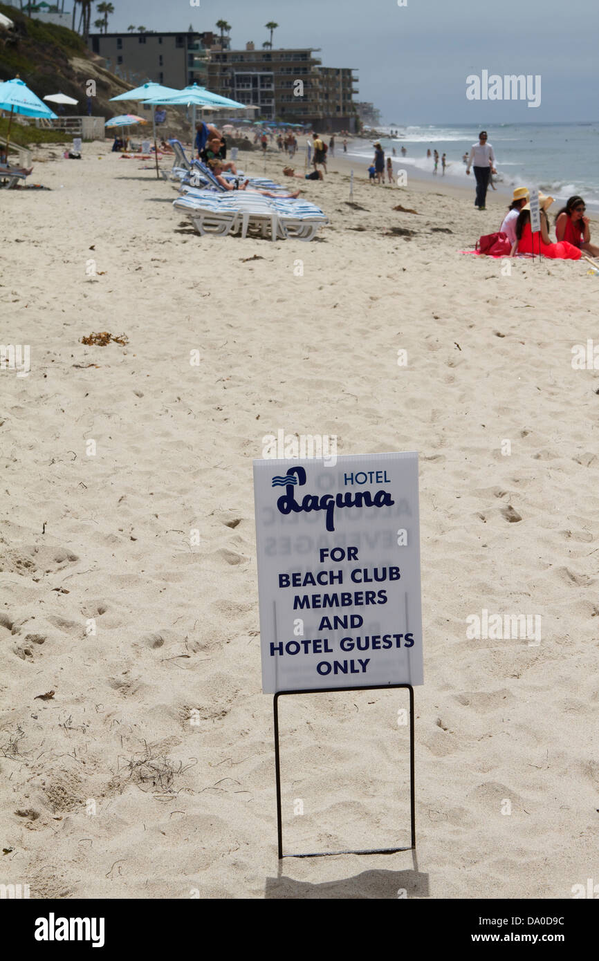 A sign on the beach at the Hotel Laguna guests only and beach club members only area. Laguna Beach California - Stock Image