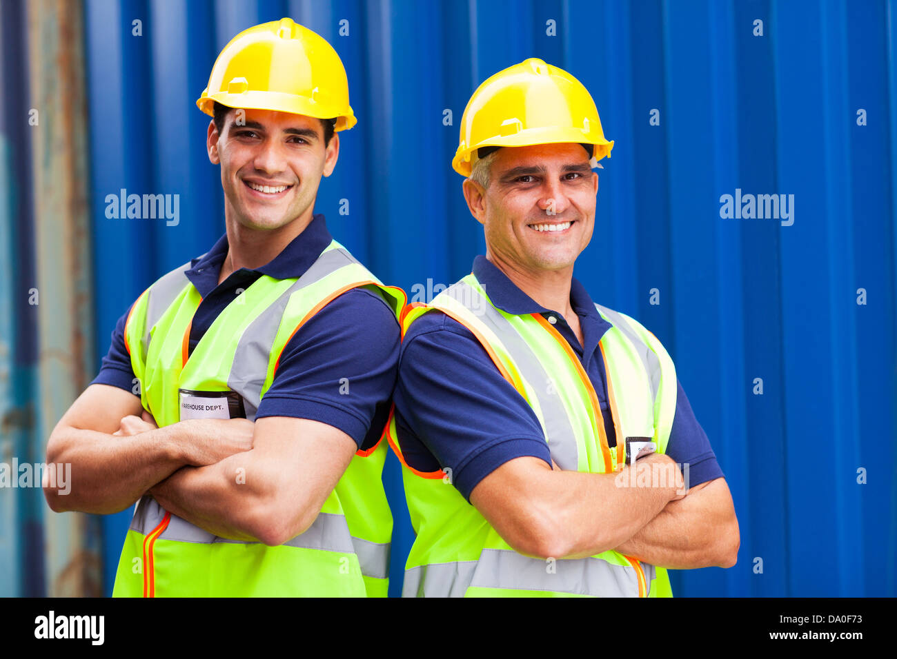 confident harbor worker portrait in container yard - Stock Image