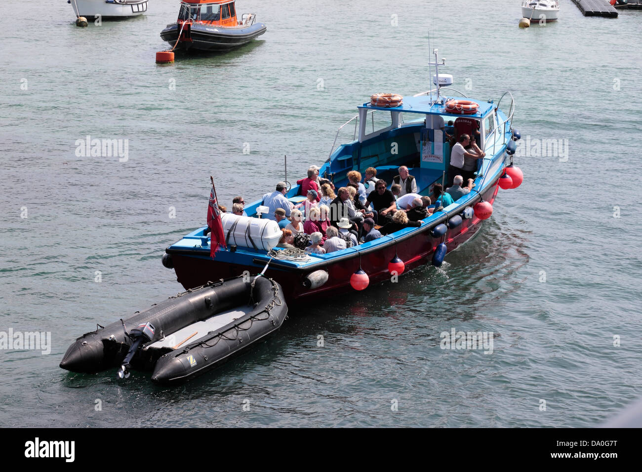 Day Trip Boat returning to St Mary's Harbour - Stock Image