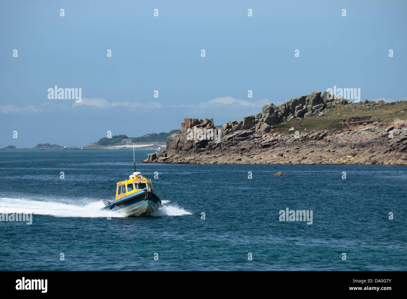 A Boat Returning to St Mary's Harbour, Isles of Scilly, UK - Stock Image