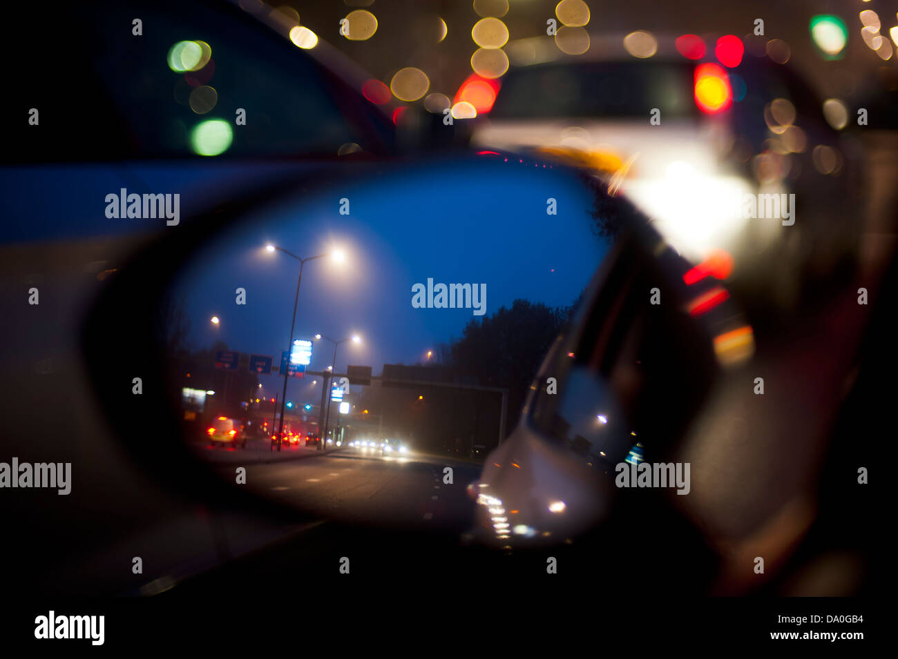 The Car Mirror With City Lights In The Rain Stock Photo 57790520