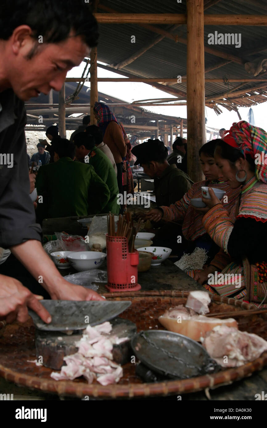 Flower Hmong women eating traditional tribal food at the market in Bac Ha, Vietnam, Southeast Asia Stock Photo