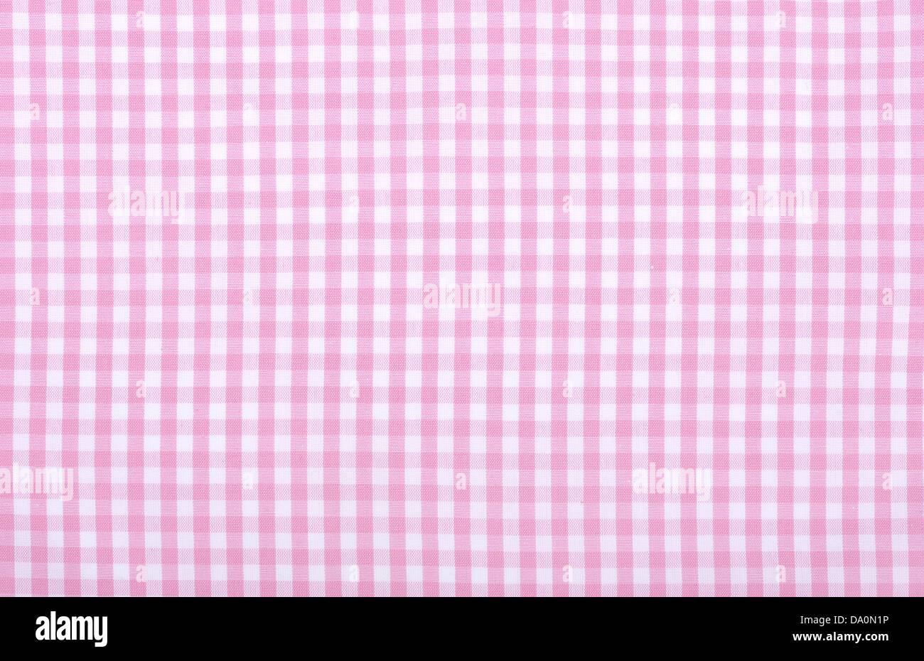 Light pink checkered fabric closeup , tablecloth texture - Stock Image