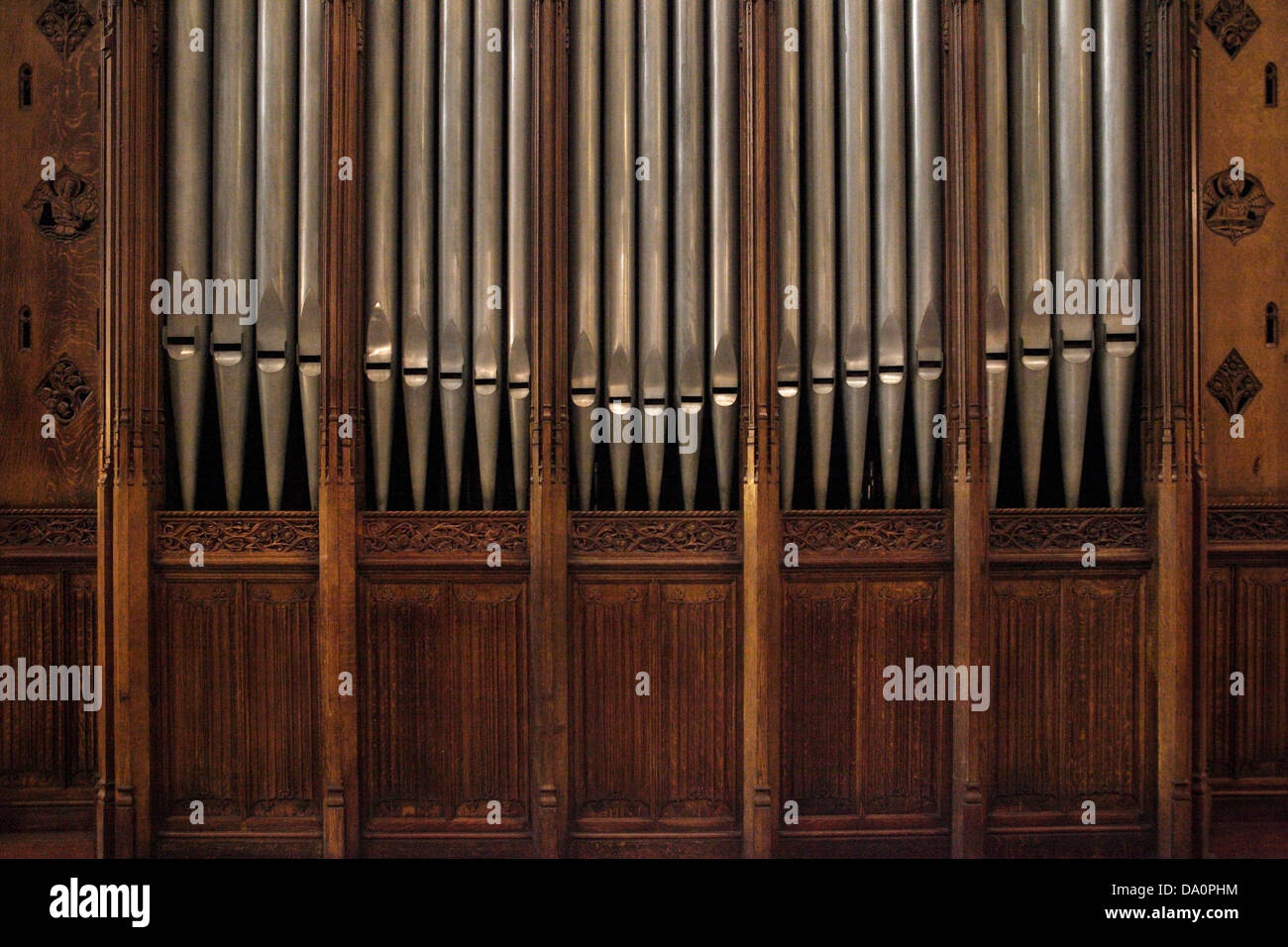 Pipes of a pipe organ in a church - Stock Image