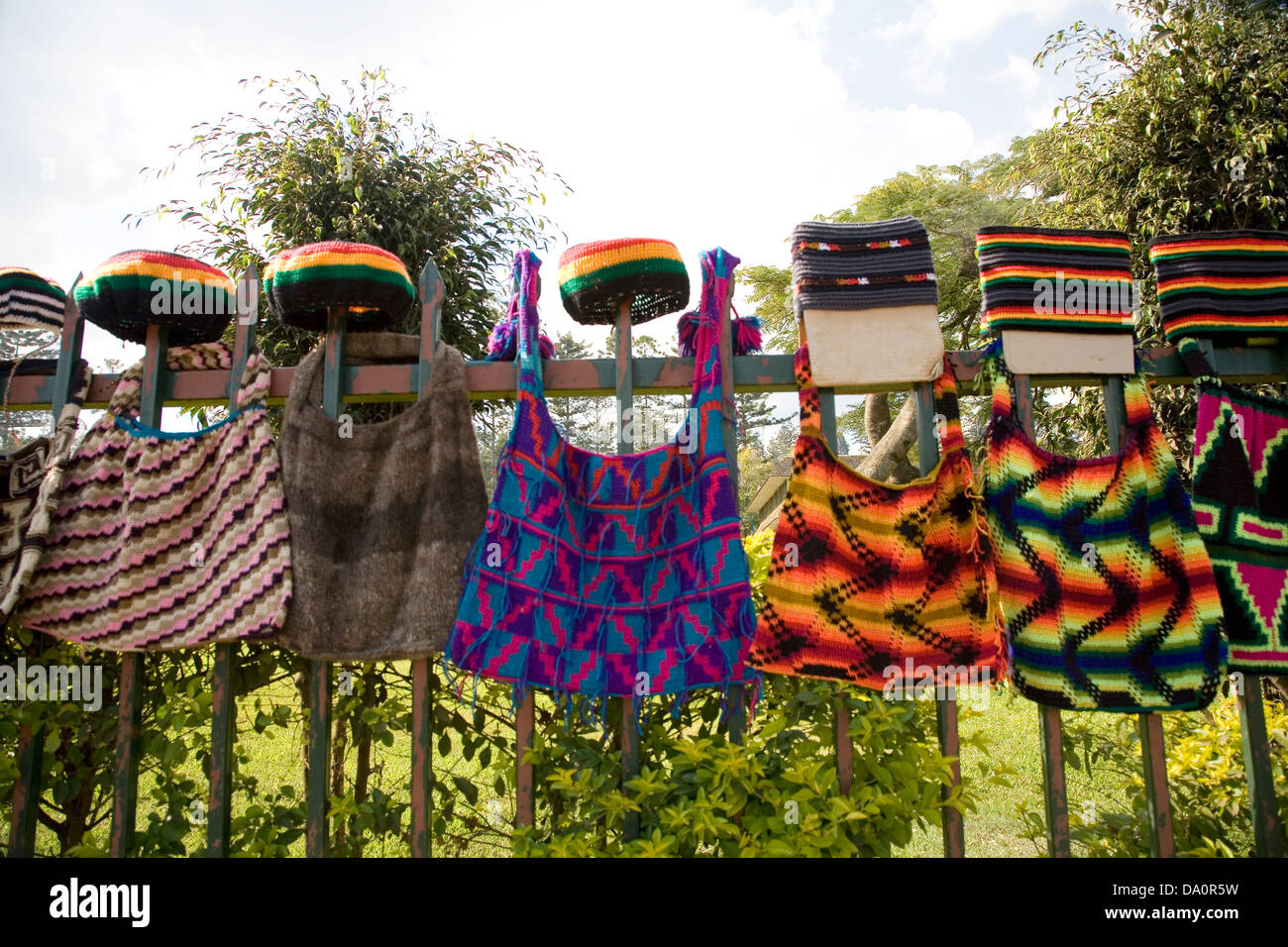 Women weave colorful bags called bilums in Goroka, Eastern Highlands Province, Papua New Guinea. - Stock Image