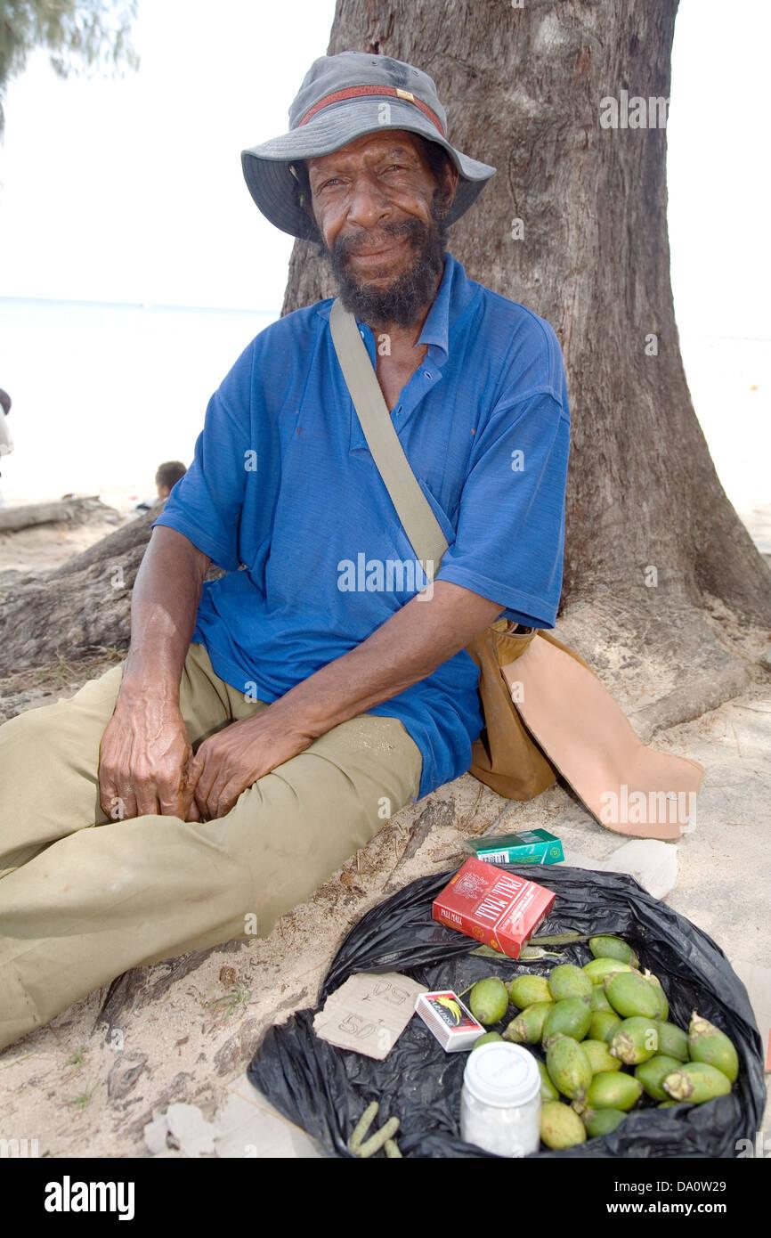 Betel nut vendor at Ela Beach, Port Moresby, Papua New Guinea. - Stock Image