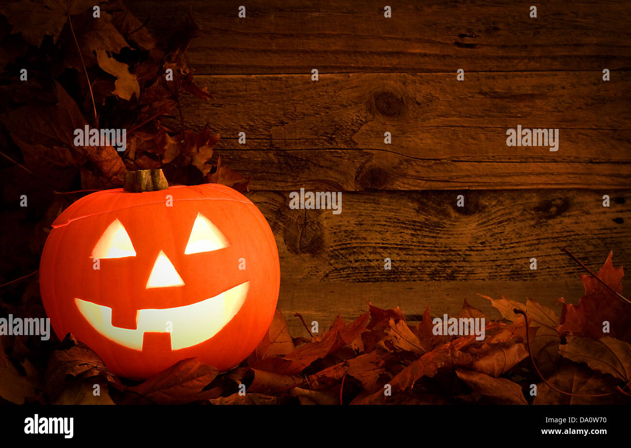 halloween pumpkin background carved during autumn to celebrate a pagan festival a modern adaptation of the festival - Stock Image