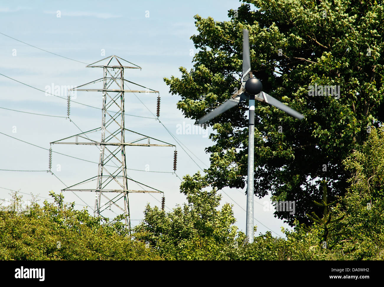 Domestic small scale wind turbine to generate electricity for a small farm or business - Stock Image
