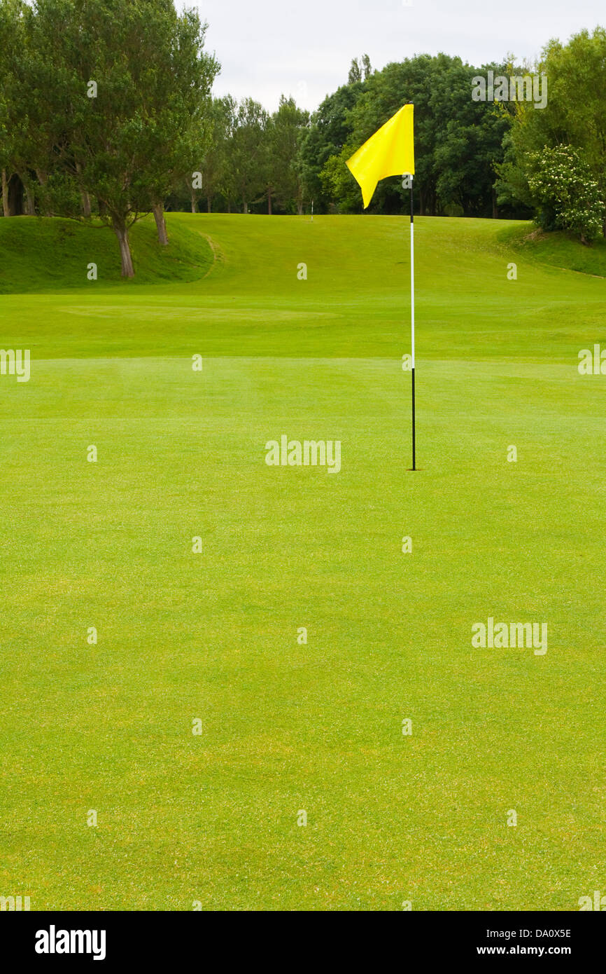 Golf course with large area for text including the flag and fairway a general golfing scene with no people - Stock Image
