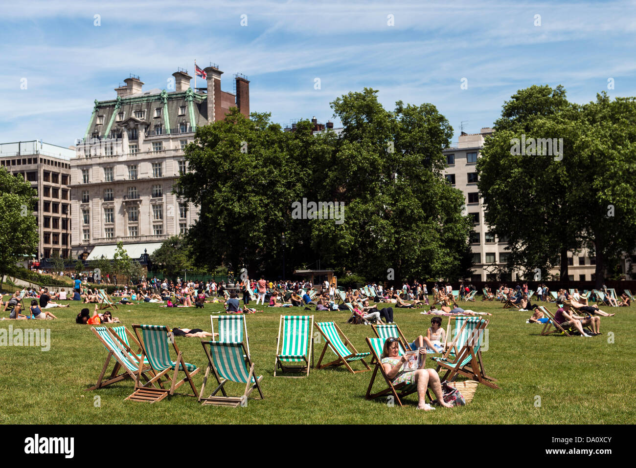 people sunbathing in green park london uk on sunday 30th. Black Bedroom Furniture Sets. Home Design Ideas