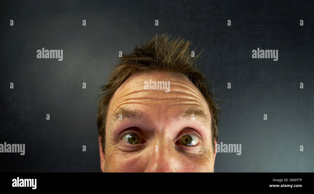 A surprised expression on a mans face - Stock Image