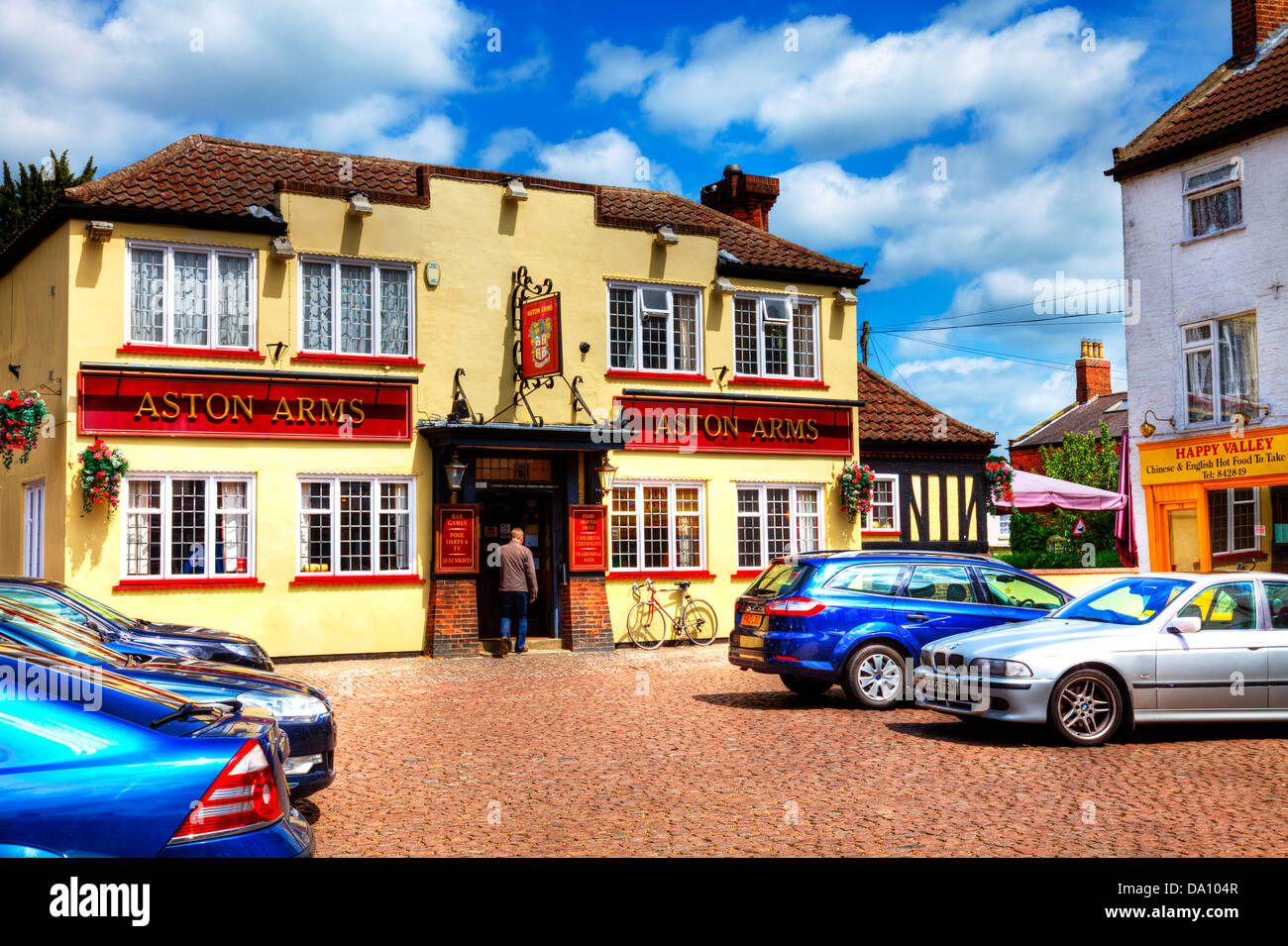 man walking into Aston Arms pub, Market Rasen town village centre, Lincolnshire, UK, England - Stock Image