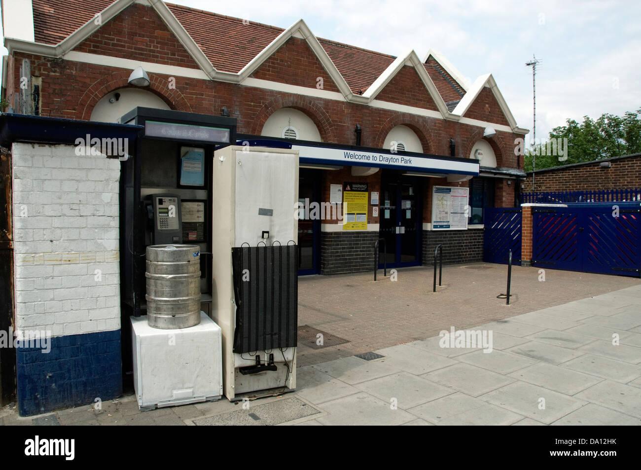 Old household appliances blocking the entrance to a public telephone box outside Drayton Park Station, Islington - Stock Image