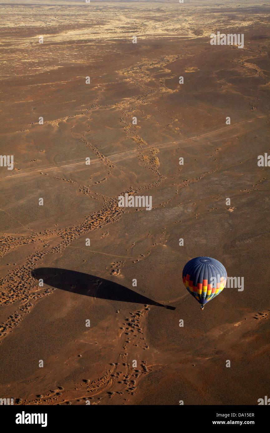 Hot air balloon over Namib Desert, near Sesriem, Namibia, Africa - aerial Stock Photo