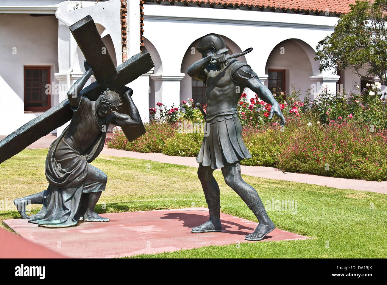 Statue of the legend of Christ carrying a cross (one of the 'Passions of Christ'), on the grounds of Mission - Stock Image