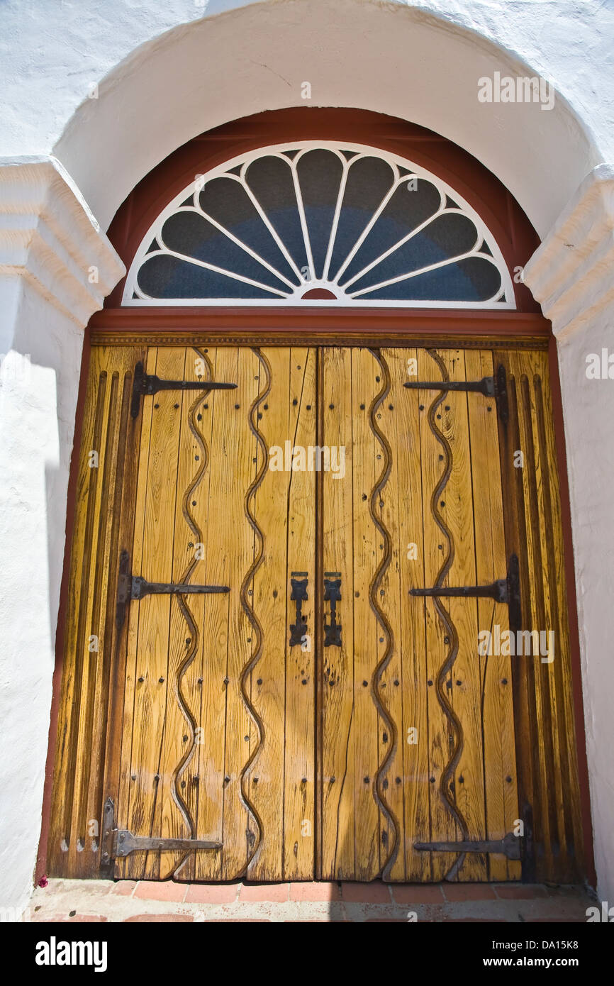 Vintage wooden door on the grounds of Mission San Luis Rey in Oceanside, CA US. This is the eighteenth of the Franciscan - Stock Image