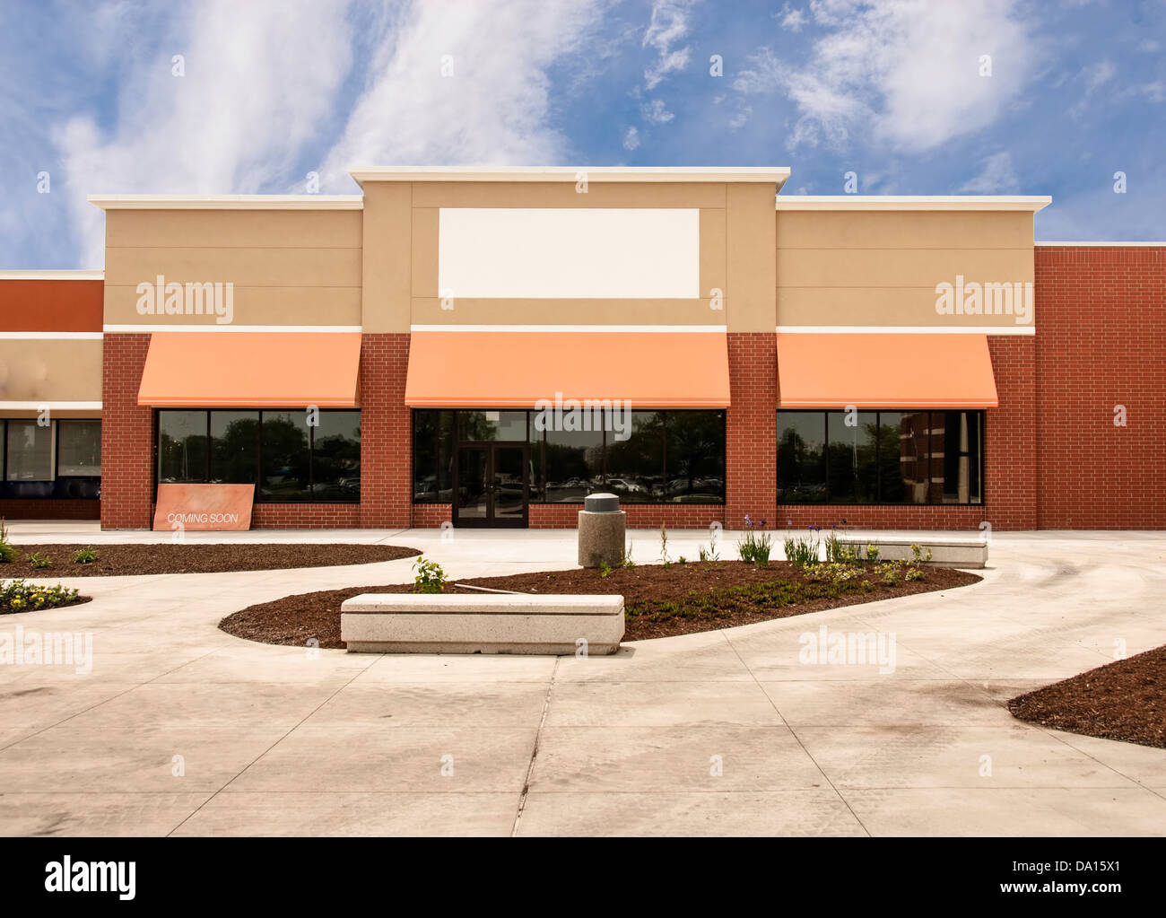 Storefront ready for new tenant at a mixed use retail strip mall - Stock Image