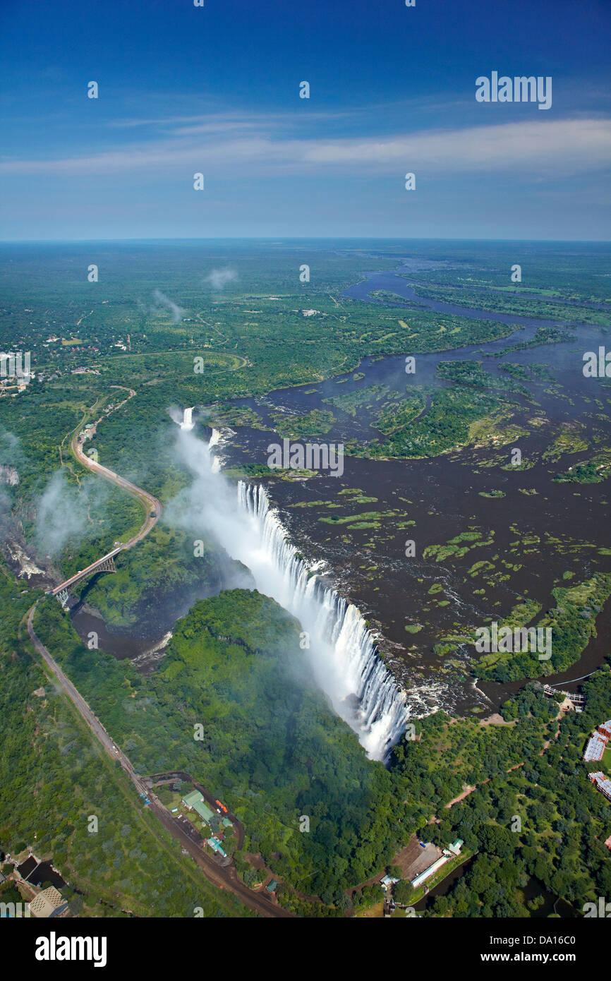 Victoria Falls or 'Mosi-oa-Tunya' (The Smoke that Thunders), and Zambezi River, Zimbabwe / Zambia border, - Stock Image