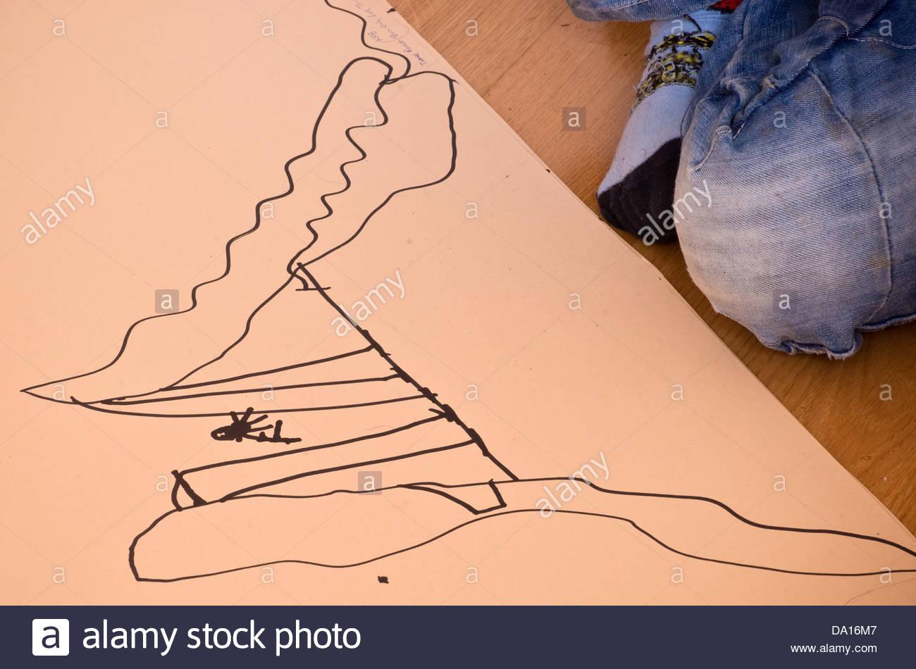 boy child children kids kid drawing art artist artwork - this is drawing of a James Bond crater man entering via - Stock Image