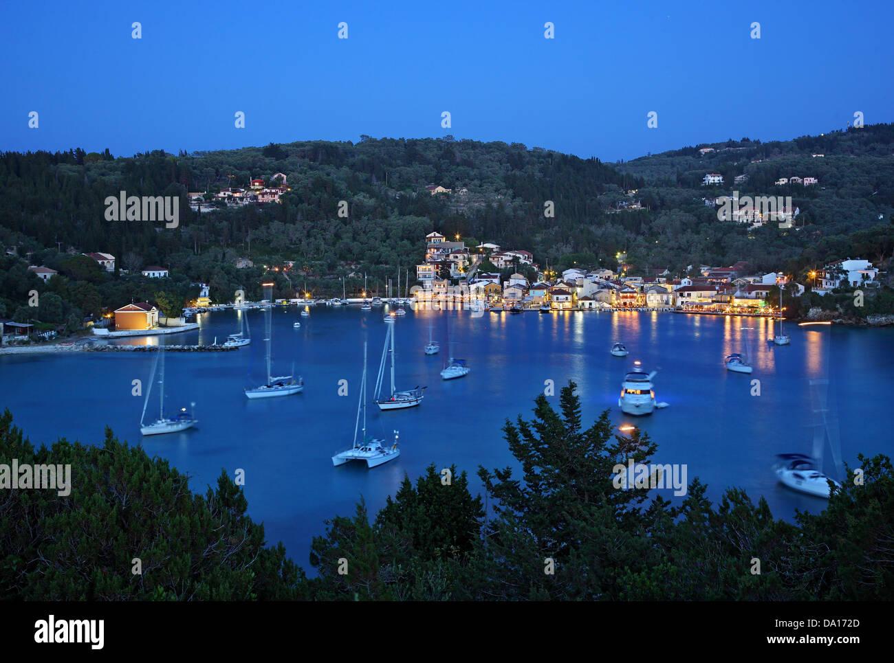 Night view of Lakka bay and village, Paxos island, Ionian Sea, Eptanisa ('Seven Islands'), Greece. - Stock Image