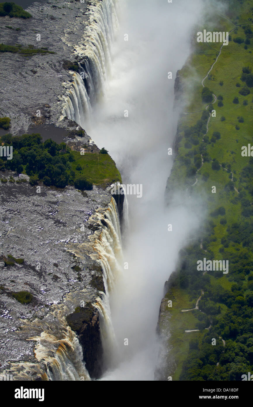 Victoria Falls or 'Mosi-oa-Tunya' (The Smoke that Thunders), and Zambezi River, Zimbabwe / Zambia border, - Stock Image