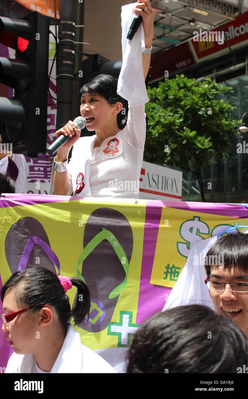 Hong Kong. 1st July 2013. Hong Kong pro-democracy legislator Claudia Mo rallies protesters ahead of the July 1, - Stock Image