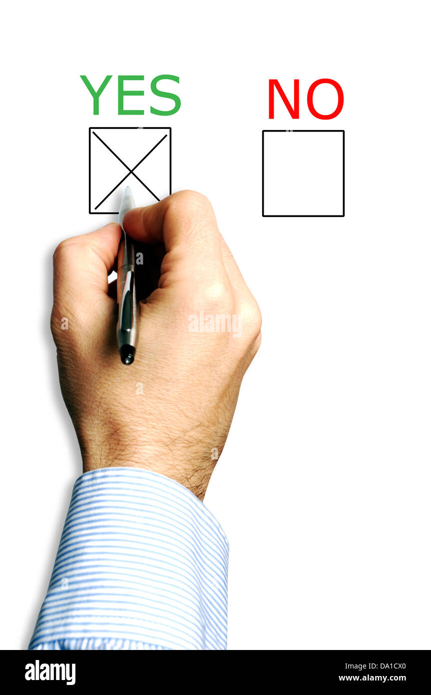 hand with pen choosing yes answer - Stock Image