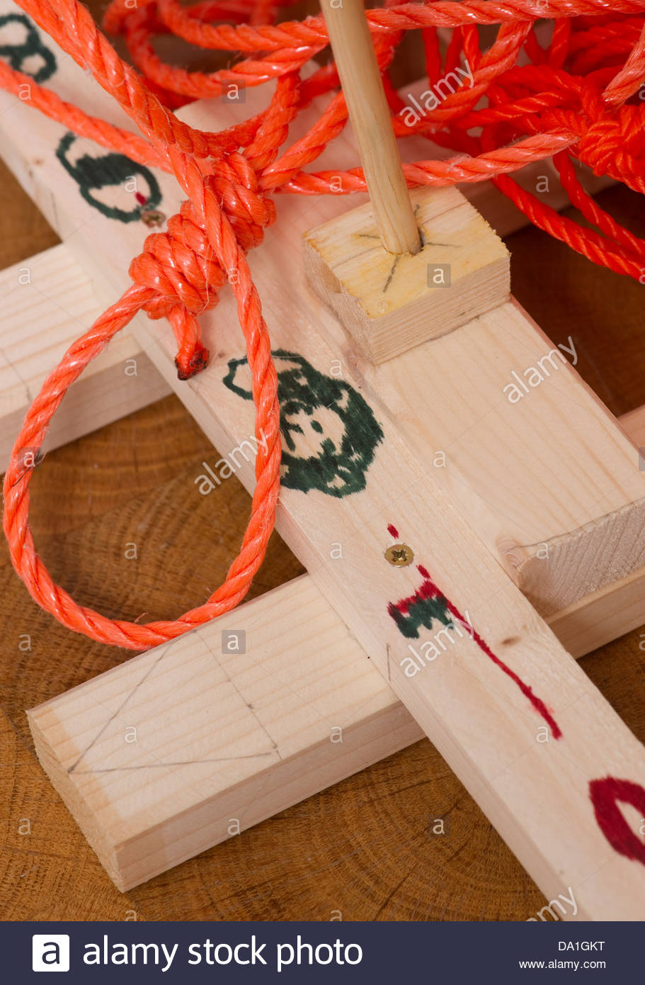 Toy wooden boat raft with nylon rope string - Stock Image