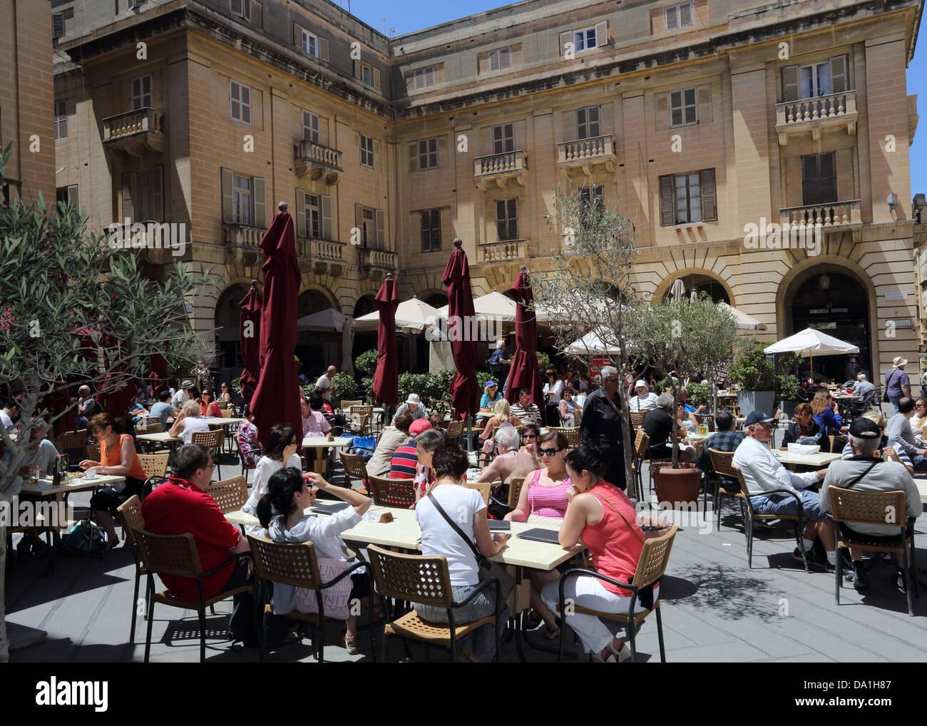 CAFE,ST.JOHN'S SQUARE,VALLETTA,MALTA - Stock Image