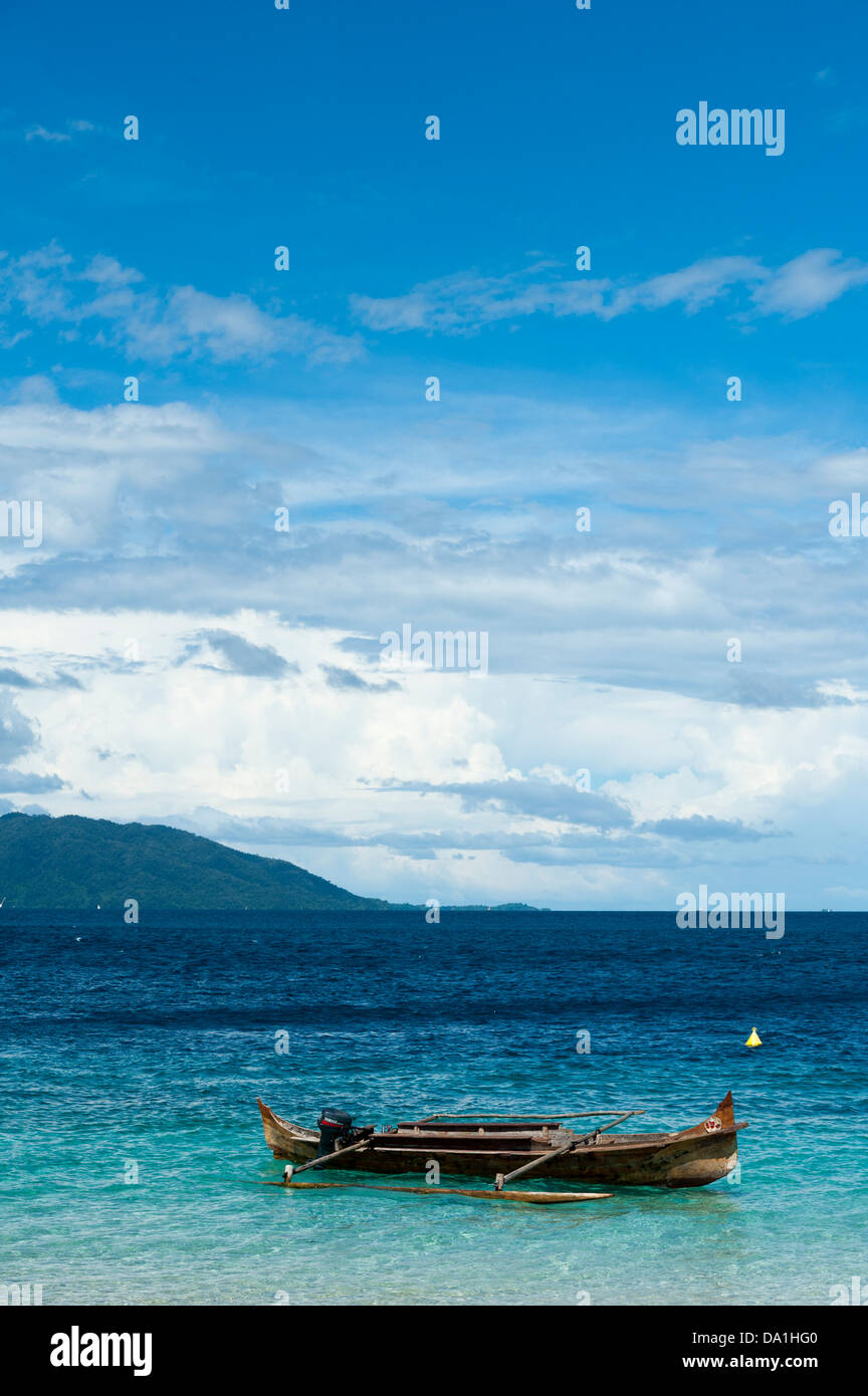 Small boats in sea in Madagascar - Stock Image