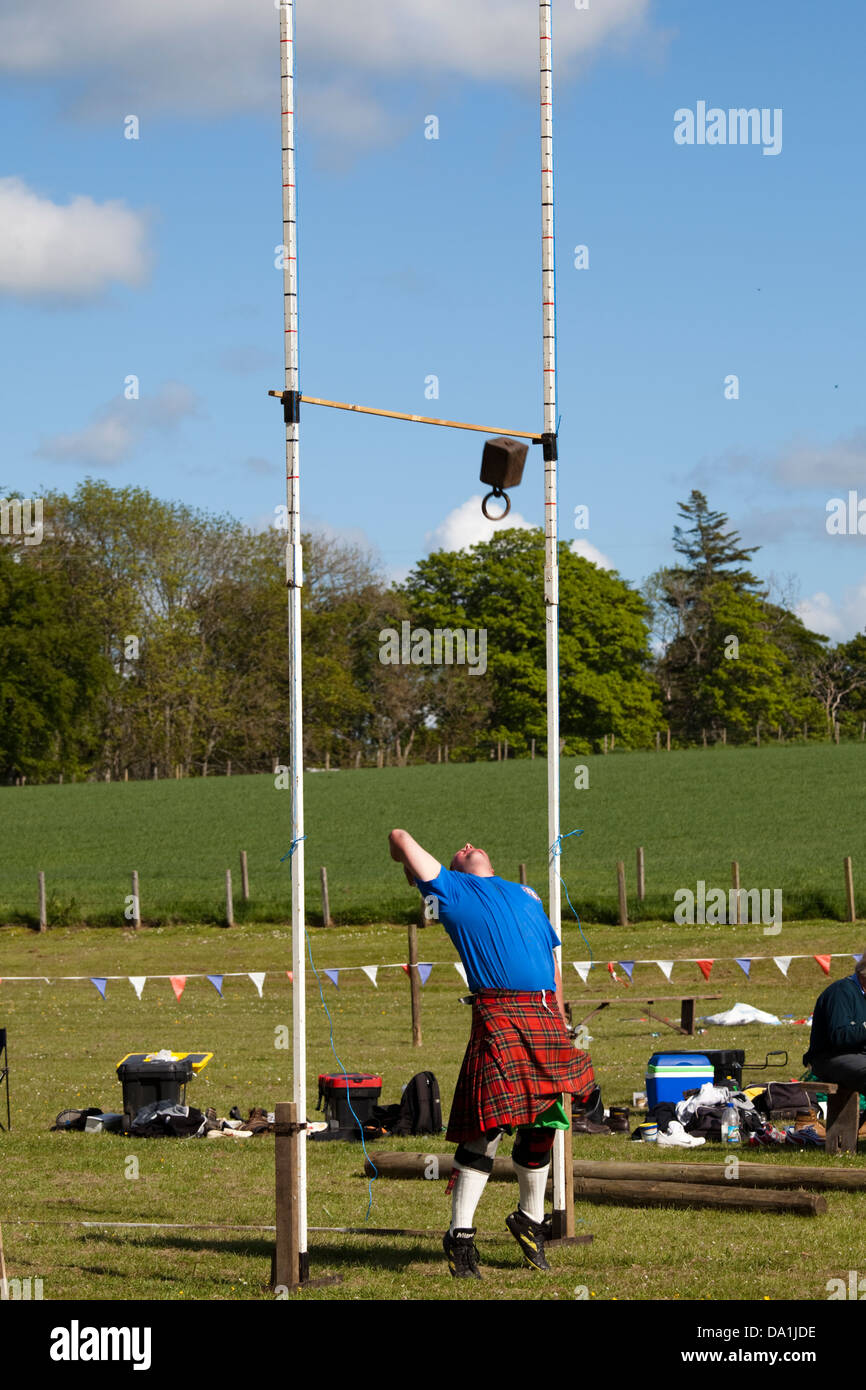 Cornhill, Scotland - June 2nd, 2012: The Weight over the Bar event at a Scottish Highland Games - Stock Image