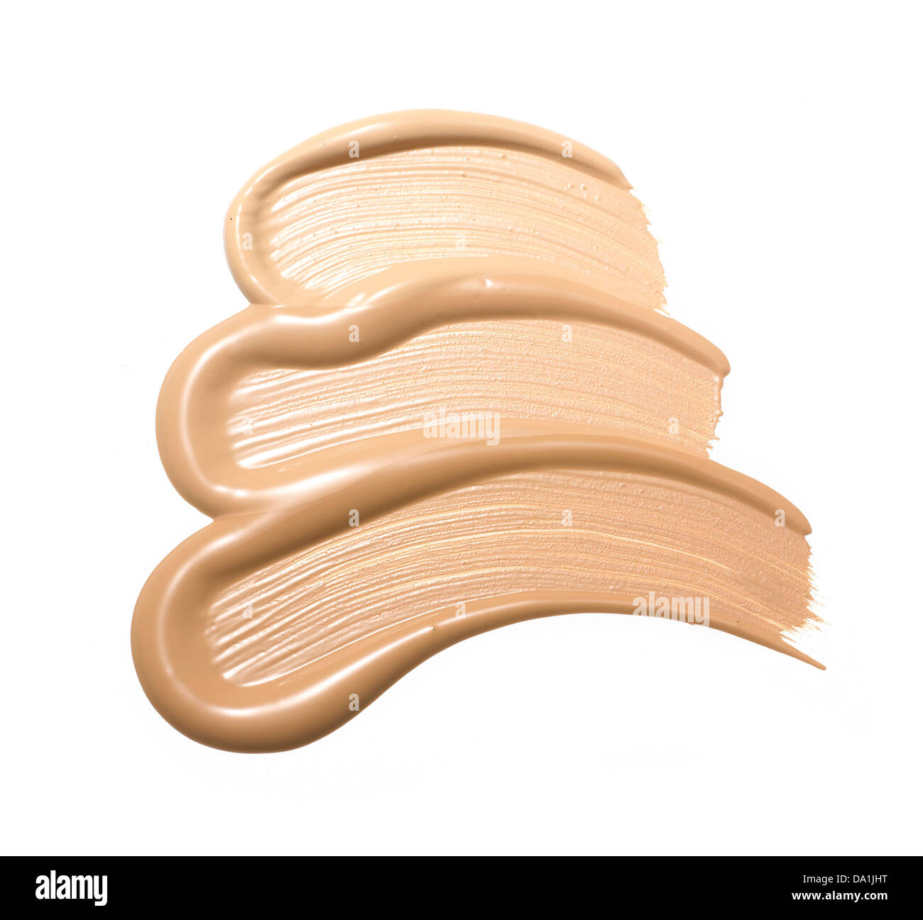 sweep of foundation makeup cut out onto a white background - Stock Image