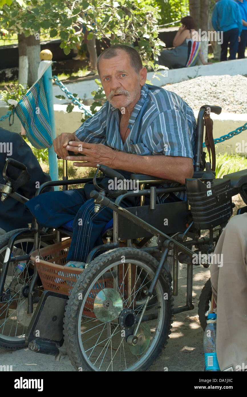 crippled asking for near the temple on the day of the Holy Trinity - Stock Image