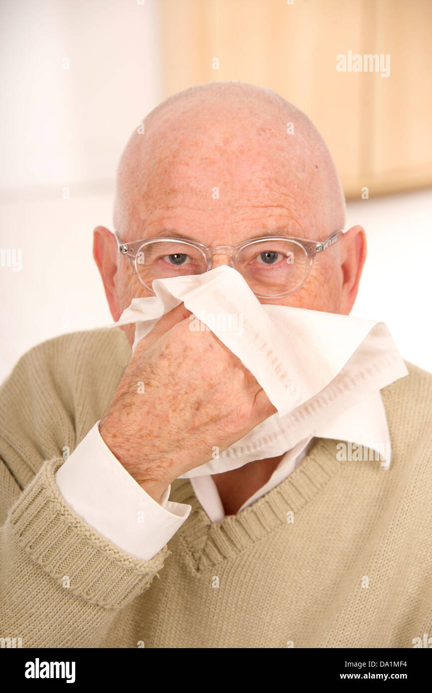 ELDERLY PERSON WITH RHINITIS - Stock Image