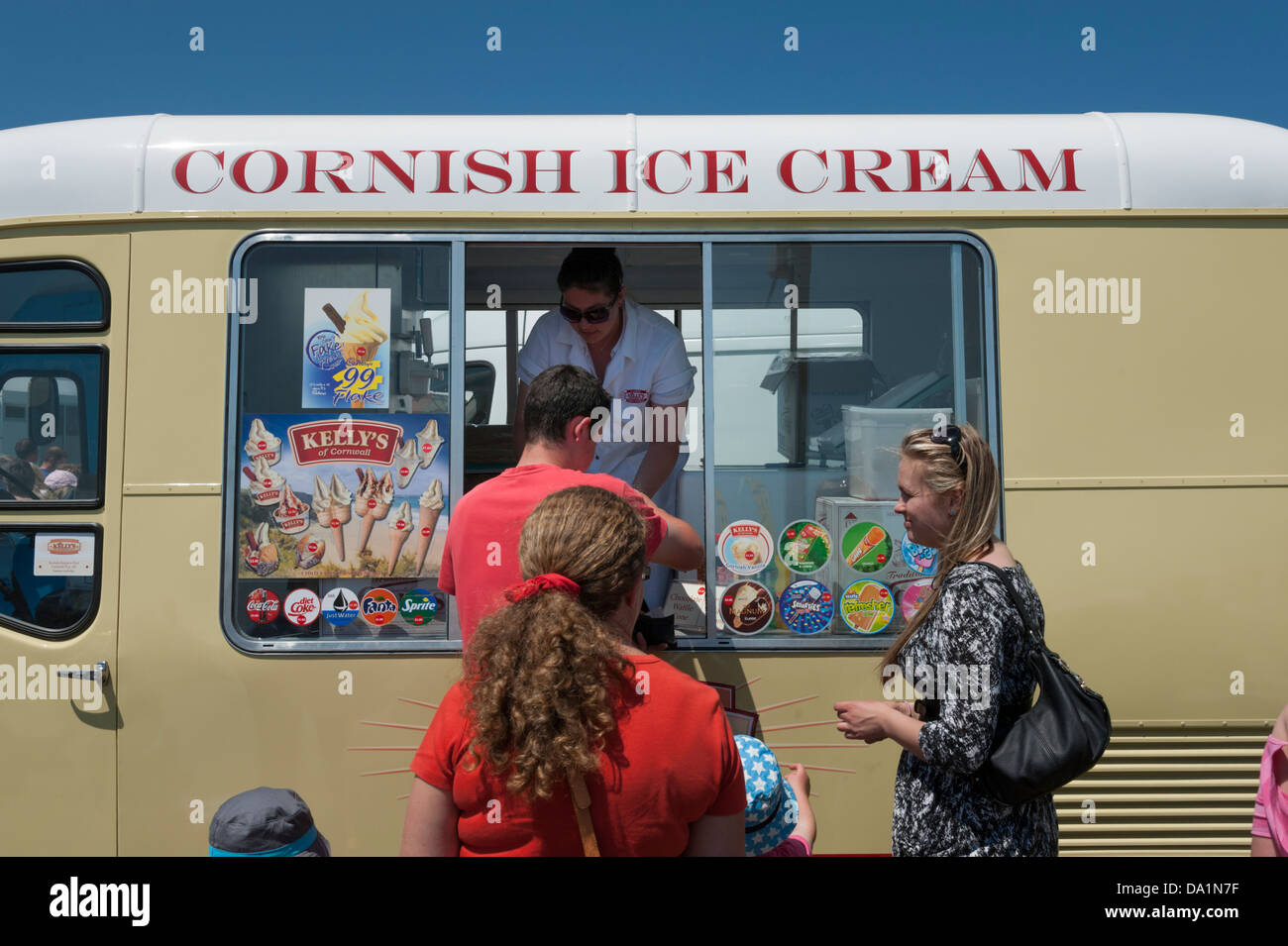 Customers buying ice creams from the Kellys Cornish Ice cream van at the Royal Cornwall Show UK 2013 - Stock Image
