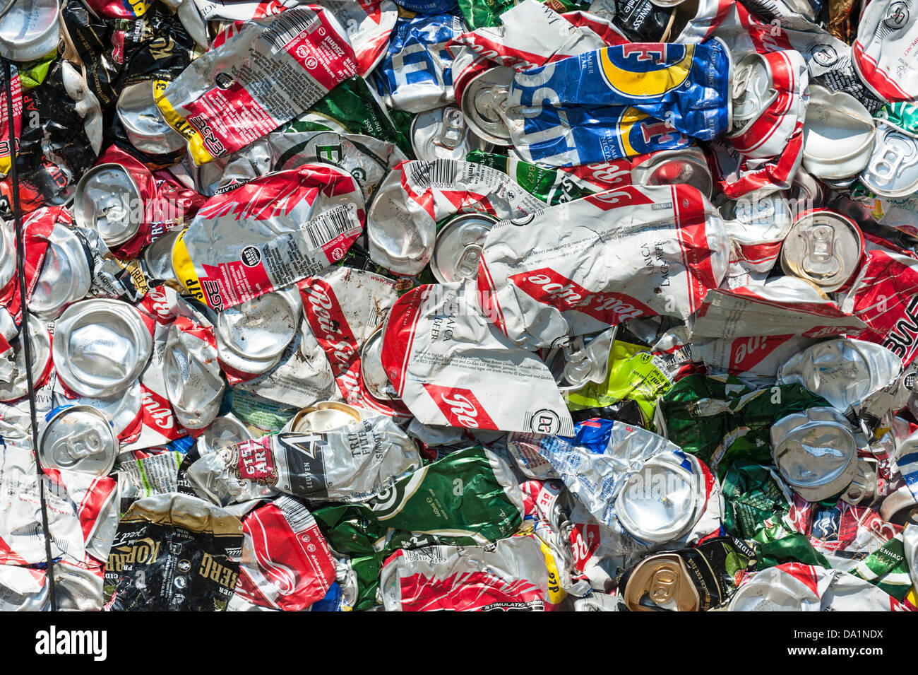 Crushed and baled aluminium cans for recycling - Stock Image