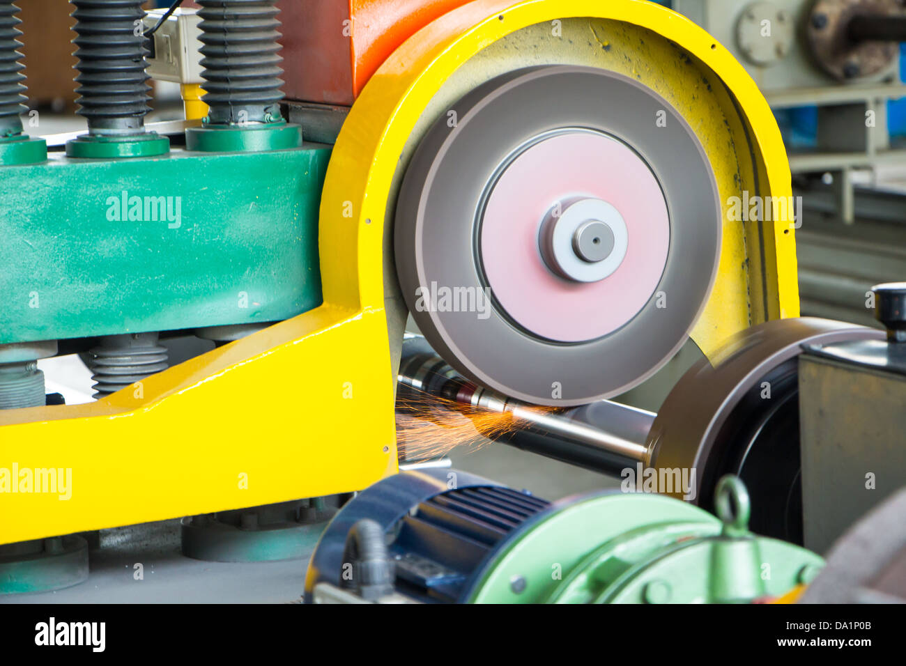 Emery in process in machinery workshop - Stock Image