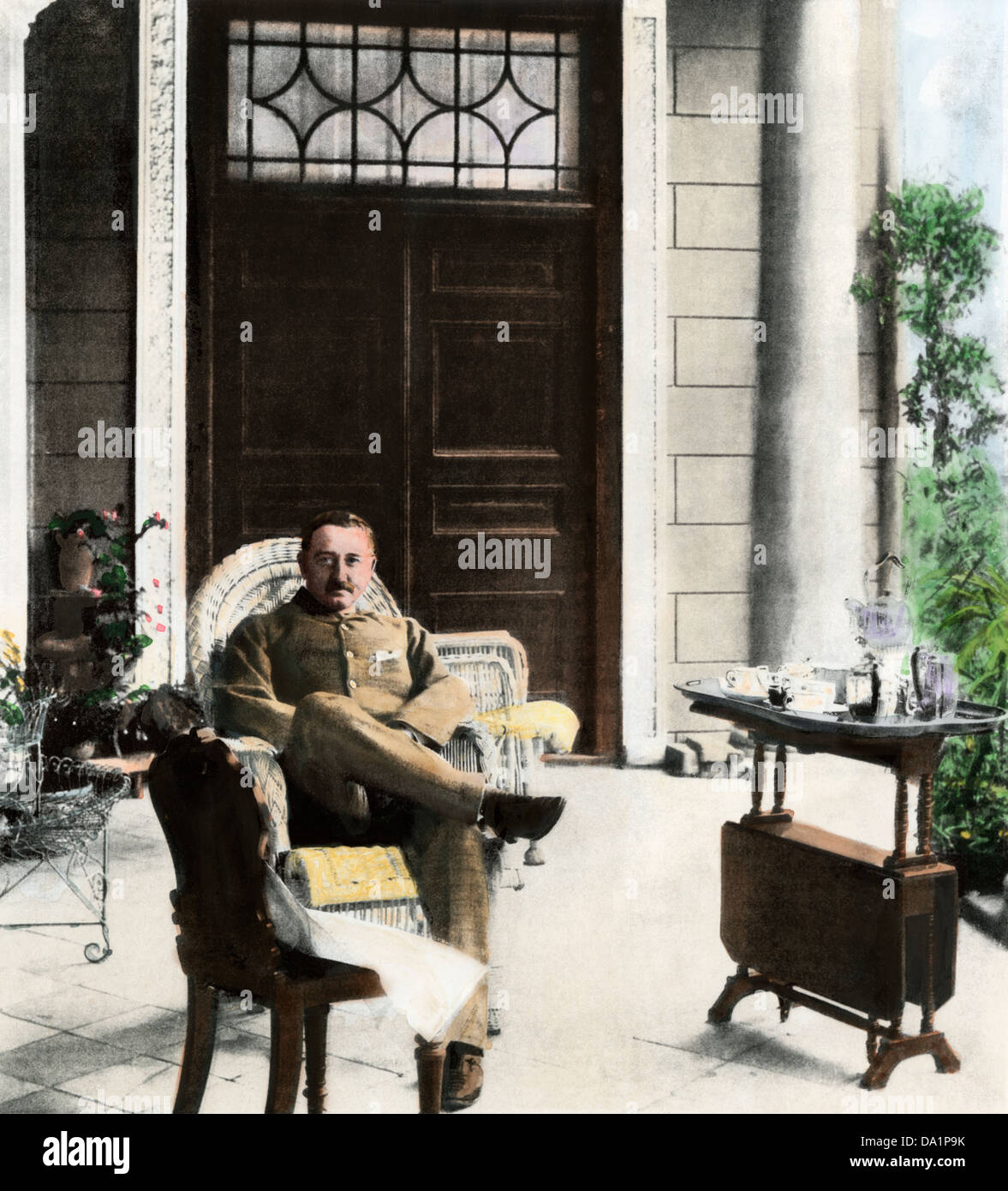 Cecil John Rhodes, British colonial administrator, on his verandah near Cape Town, South Africa, c. 1900. Hand-colored - Stock Image