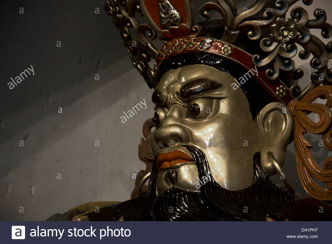 God statue in entrance to temple courtyard statues in the Po Lin Monastery - Stock Image