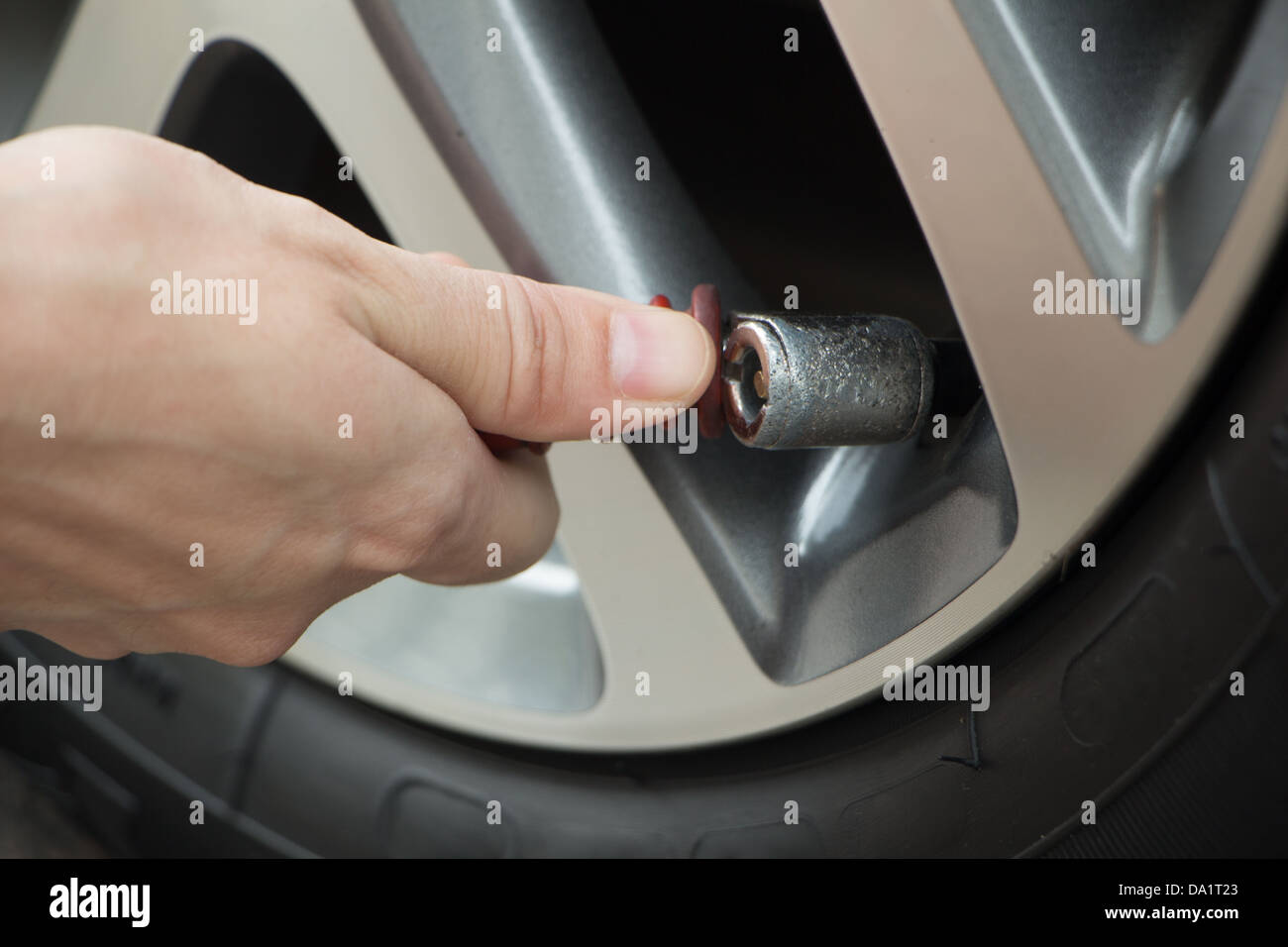 How To Put Air In Car Tires >> Hand Fill Air Into A Car Tire Stock Photo 57818491 Alamy