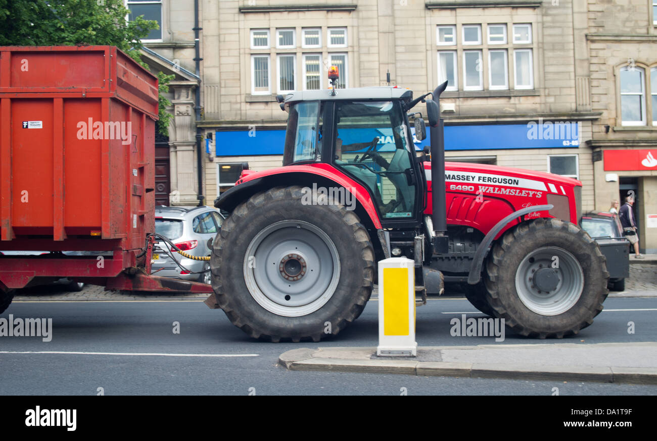 Tractor and trailer driving through Skipton town Centre - Stock Image