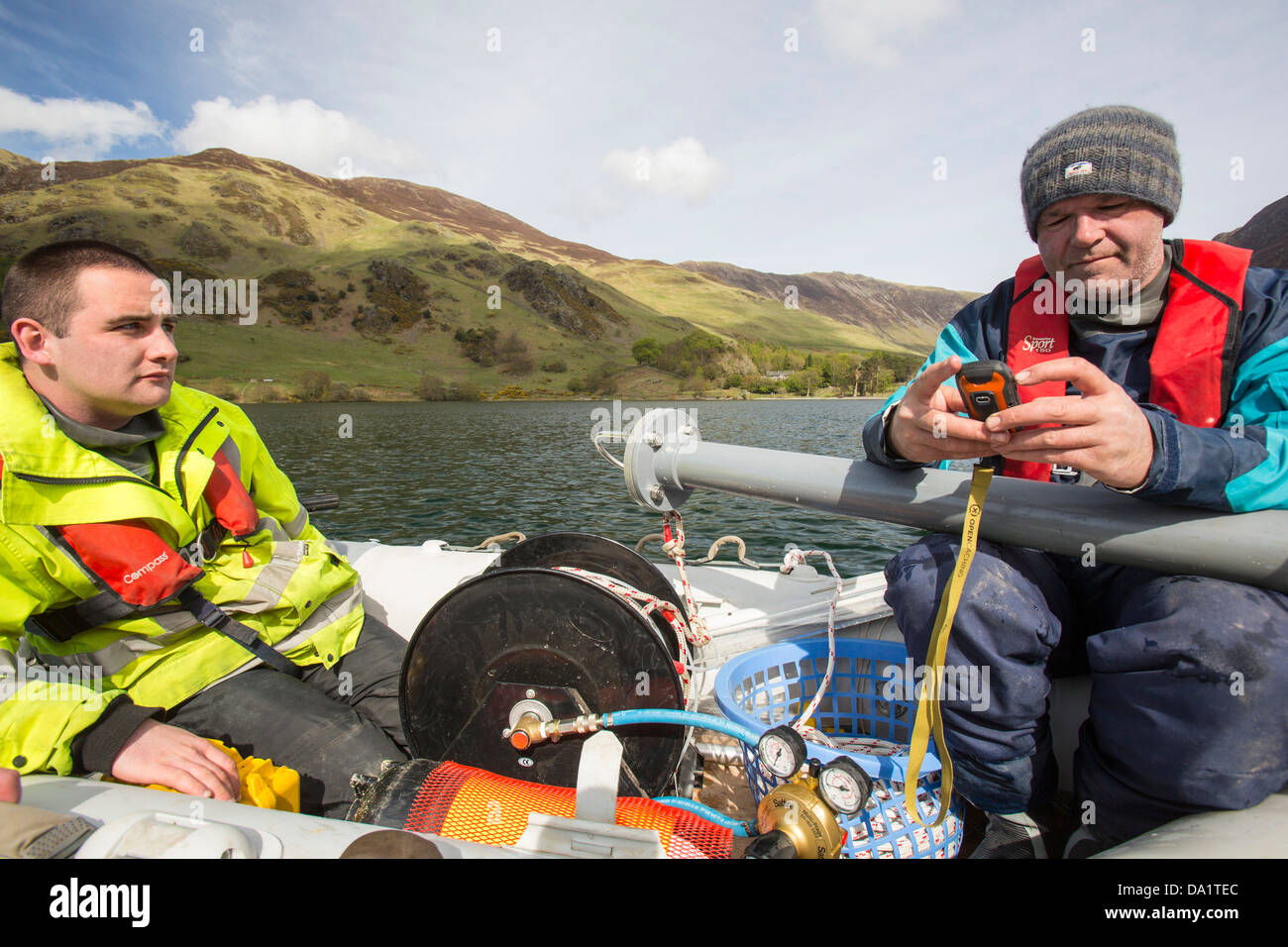 Dr Jeff Warburton of Durham University preparing to take sediment cores from the bottom of Buttermere Lake - Stock Image