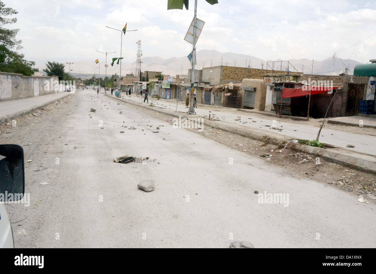 Road seen closed during funeral prayer of for suicide bomb blast victims of Aliabad area of Hazara town in Quetta - Stock Image